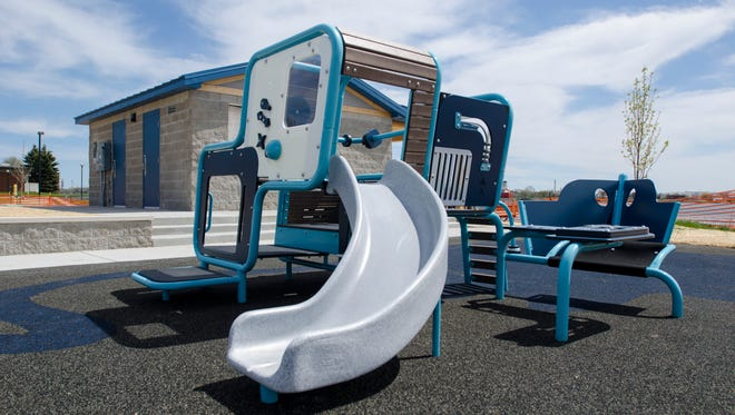 New playground equipment is installed Monday, May 9, at Chrysler Beach in Marysville.
