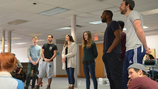 """Members of the 2014-15 company rehearsing for That High Lonesome Sound,"""" a selection in the 2015 Humana Festival of New American Plays."""