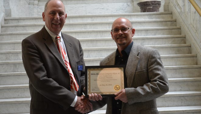 State Historic Preservation Officer Jim Draeger presents a certificate to Todd Hutchison