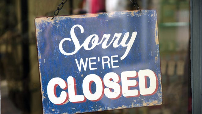 Vintage closed sign in shop window.