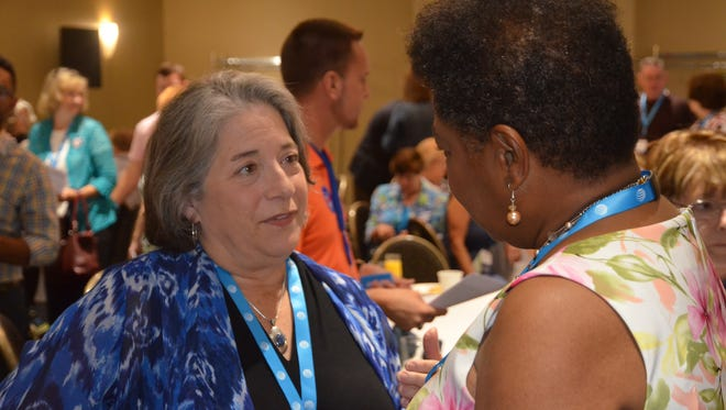 Knoxville Mayor Madeline Rogero talks with Rep. Brenda Gilmore after she addressed Tennessee's delegation at the Democratic National Convention on Monday, July 25, 2016.