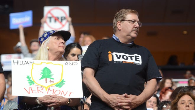 Billi Gosh, left and Vermont Secretary of State Jim Condos stand with the Vermont delegation on the second evening of the Democratic National Convention on Tuesday, July 26, 2016.