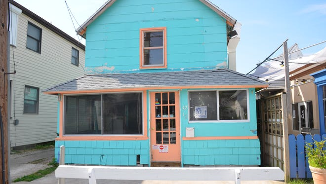 The building that held one of the original Rehoboth Camp Meetings has been bought by the owners of Blue Moon Restaurant and will be renovated into a new restaurant.