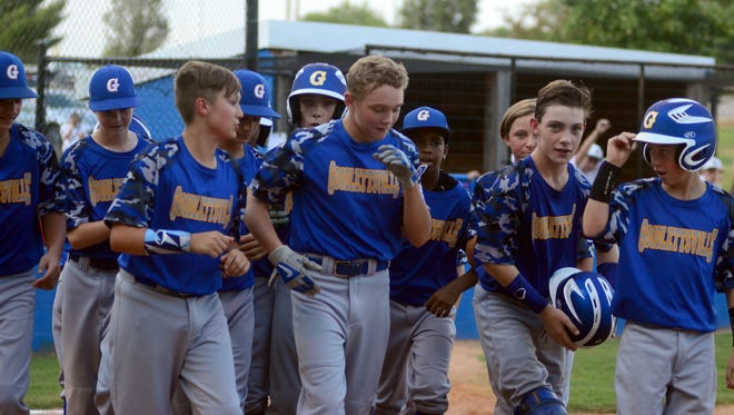 The Goodlettsville Little League All-Star team congratulates Zach McWilliams (center) during a game earlier in the postseason. Goodlettsville defeated Peachtree City (Ga.) 15-3 on Wednesday to win the Southeast Regional championship and advance to the Little League World Series.
