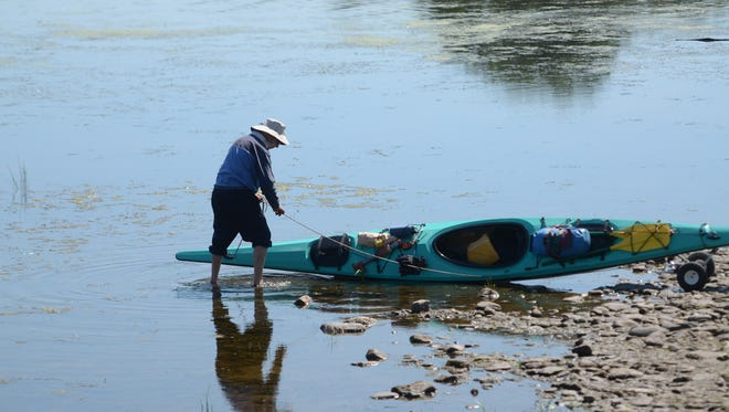 Gary Castle of Shelburne launches his kayak into muddy, shallow water on Aug 20 2016