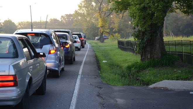 The morning traffic on Rossview Road consists mostly of parents dropping their kids off at school.