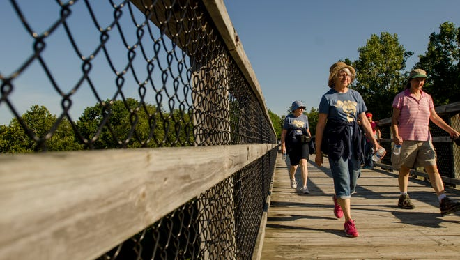 Walkers cross the old trestle bridge Monday, Sept. 5, 2016, during the annual Trestle Trek along the Wadhams to Avoca Trail.