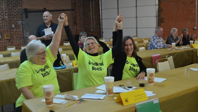 From left, Ann Hunter, Peggy Cline and Linda Cook celebrate after winning the 2016 Wichita Adult Literacy Council's Adult Spelling Bee.