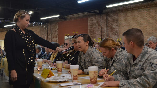 In this file photo, 2nd Lt. Jacqueline Jastrzebski spells a word for Team Sheppard during the WALC adult spelling bee. Also on the team were 2nd Lt. Britanny Curry, and Senior Airman Kyle Gese. This year's event will be Nov. 15 at The Forum, 2120 Speedway.