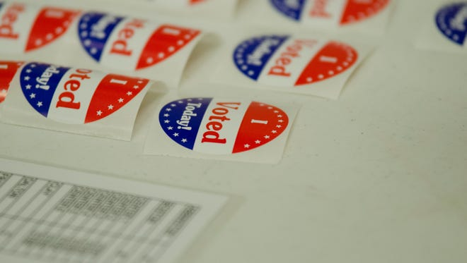 "Several ""I Voted Today"" stickers sit on a table at First English Lutheran Church in Richmond on the morning of the general election, Nov. 8, 2016"