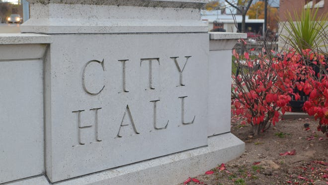 The sign for City Hall in the City of Manitowoc.