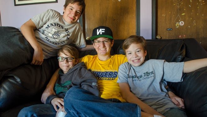 The Trendy brothers, from left, Charles, 15, Brendan, 12, Dakota, 18, and Alec, 11, pose together Sunday, Nov. 13, at their home in Port Huron Township.