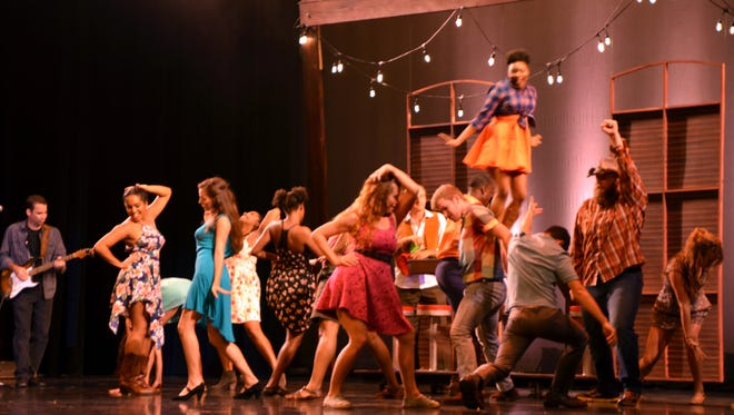 """Dancers perform in a scene from the Lafayette debut of """"Jambalaya, the Musical,"""" held Sept. 8 at the Heymann Performing Arts Center."""