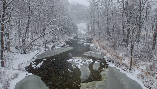 The Black River begins to ice over below Abbottsford Road  Sunday, Dec. 11, in North Street.