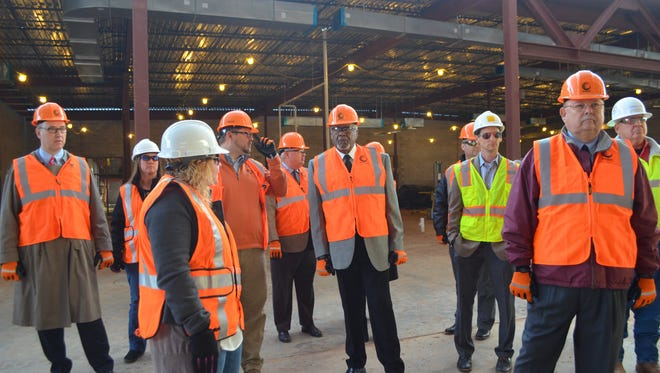 Wichita Falls ISD Career Education Center Coordinator Michelle Wood, third from left, leads a tour of the 123,000-square foot, under-construction CEC facility. The tour included school board members Tom Bursey, fifth from right, and Bill Franklin, second from right.