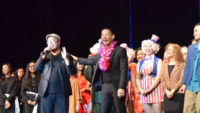 """Ernest Ochoco (left), director, gives thankful remarks to Jojo Urquico (right), one of the original cast member for the European Tour as well as the Asian Tour of """"Miss Saigon."""" On Dec. 2, Urquico joined a cast of Guam's very own singers and actors. He joined Guam's production of the musical on Dec. 2, 2016 at Southern High School."""