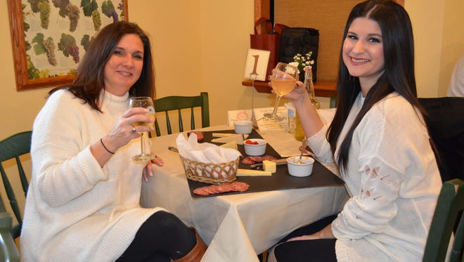 Sherri Worden of Vineland and Shelby Bassetti of Landisville enjoy specialty platters and wine during the Winter Wine Weekend at Bellview Winery. Photo/Jodi Streahle
