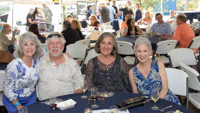 Brenda Truxillo, Stan McMurtrie, Penny Daye and Jo Ann Slaydon enjoy last year's Perdido Wine & Art Festival.