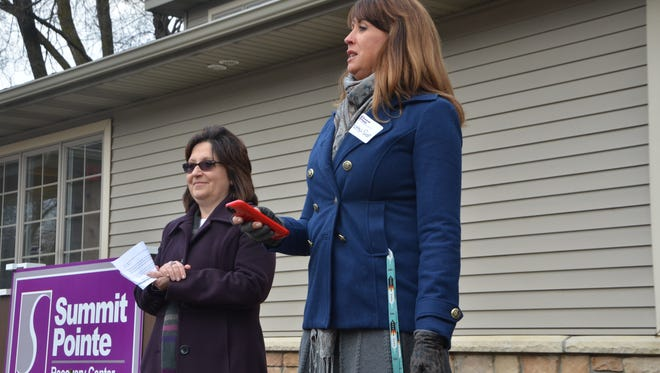Summit Pointe CEO Jeannie Goodrich, left, and Summit Pointe Board Chairwoman Kathy-Due Dunn address am audience at Thursday's ribbon cutting ceremony for the new Recovery Center.