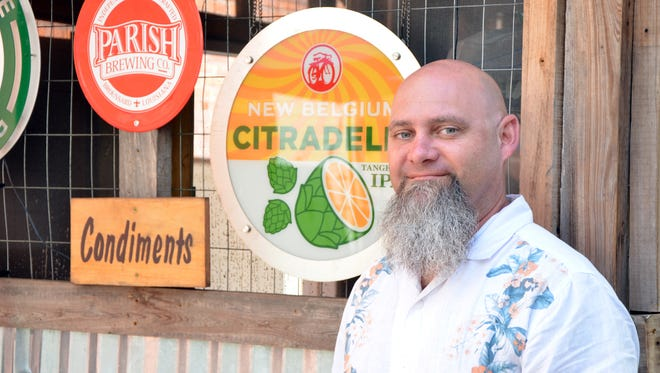 Paul Ayo, self proclaimed cullinary ambassador for the Wurst Biergarten, gears up for his pop up dinner featuring local ingredients.