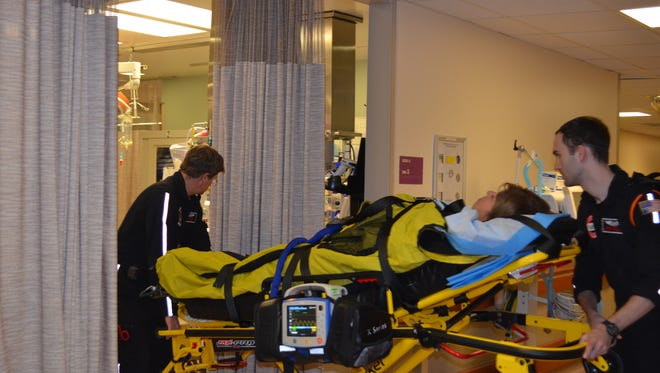 """During a drill at University of Cincinnati Medical Center, first responders bring in a """"patient"""" for care. UCMC undergoes almost weekly drills to be ready for incidents such as the Cameo nightclub shooting Sunday morning."""
