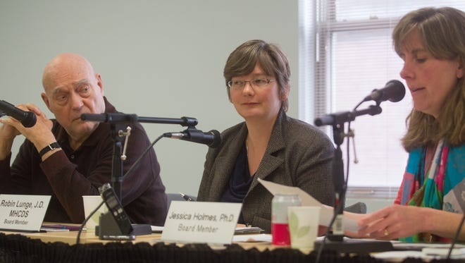 Members of the Green Mountain Care Board, from left, Con Hogan, Robin Lunge and Jessica Holmes meet in Montpelier on April 20, 2017.