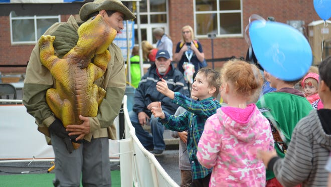 The afternoon rain showers did not turn away children from the Rivers and Spires Festival kids zone Friday night.