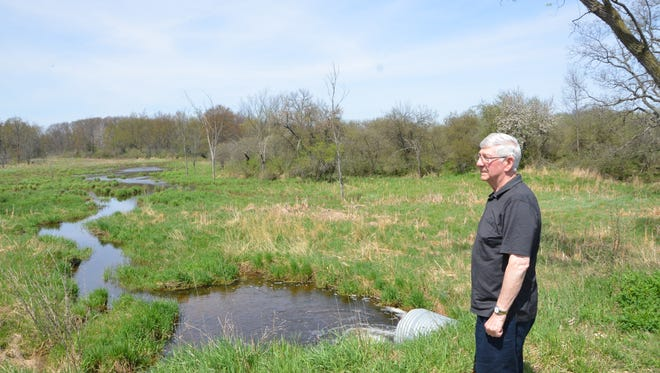 Larry Holcomb stands at one of his favorite places on his Big Marsh Farm property in Convis Township.