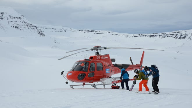 Skiers unload from an Eleven chopper in the mountains of Iceland's Troll peninsula