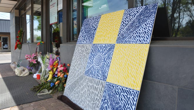 A mosaic created by William Argetsinger for Frankie Zanetti sits outside Battle Creek Tile and Mosaic Thursday.