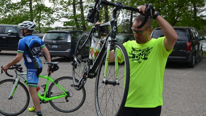 Frank Feraco prepares his bike for Wednesday's Ride of Silence event at Willard Beach.