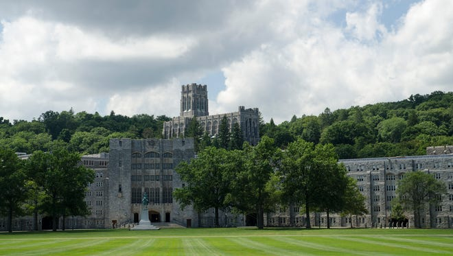 The Military Academy at West Point, New York. Parade grounds in foreground with Washington Mess Hall and Cadet Chapel in distance.