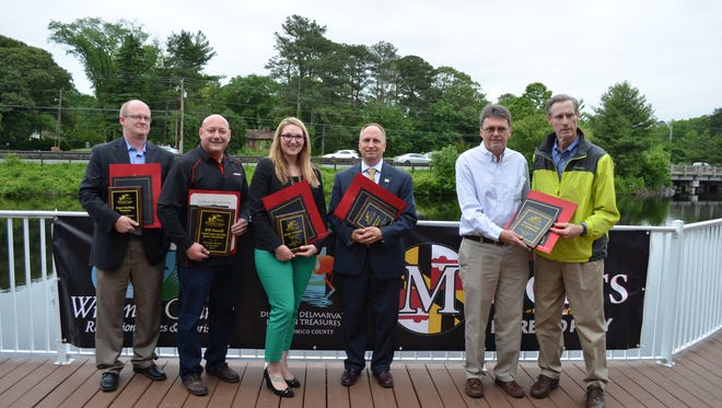 (L-R): Chris Smith, Bill Dowell, Chelsey Jones, Terry Hasseltine, Dan Williams and Art Cooley stand with awards from Wicomico County. Wicomico County's tourism division recognized its strongest partners during a reception and awards ceremony on Wednesday, May 24, 2017 at the Wicomico County Visitor's Center.