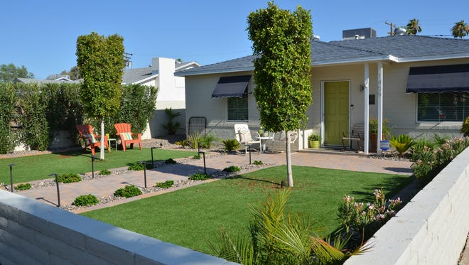 It's not uncommon for strangers to compliment the Beauchmans on their front yard, which features artificial grass, navy window treatments and a lime green front door.