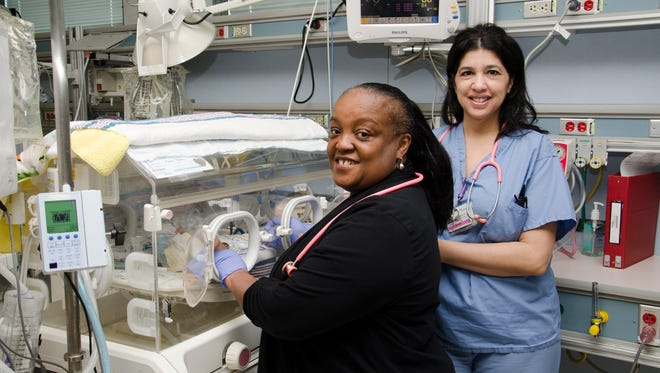 Nurses Sharon Williams (left) and Dolly Allen are members of the award-winning Saint Peter's Neonatal Intensive Care Unit at The Children's Hospital at Saint Peter's University Hospital. The American Association of Critical-Care Nurses has again bestowed a silver-level Beacon Award for Excellence in Nursing Care on the Saint Peter's NICU nursing team. Saint Peter's was the first NICU in New Jersey to receive the Beacon Award.