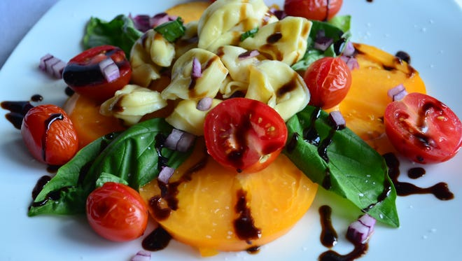 This triple tomato salad served with triple cheese tortellini is best made with local or homegrown tomatoes. An excellent quality oil and balsamic vinegar is important, too.