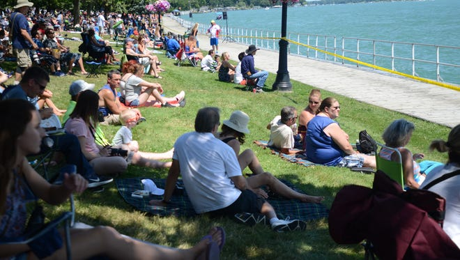 Crowds gather for the start of the powerboat races in St. Clair on Sunday