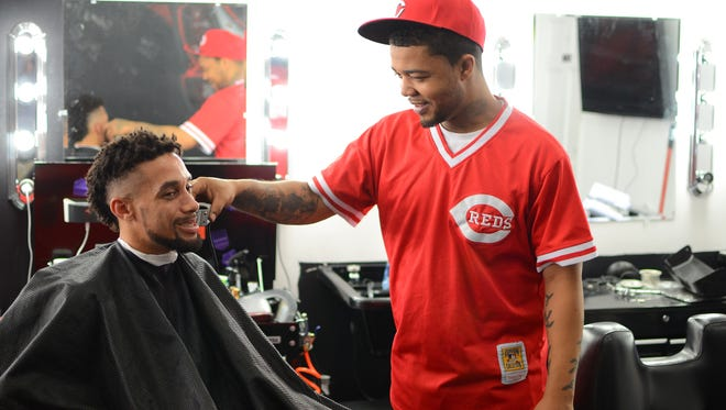 Reds center fielder Billy Hamilton gets a cut at Illest Salon Sneaker Sports.