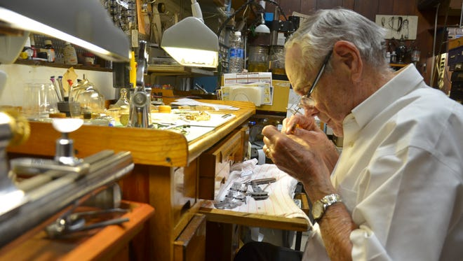 Ralph Hutchinson repairs a watch at his work bench at Hutchinson Jewelers in Boonville, Indiana.