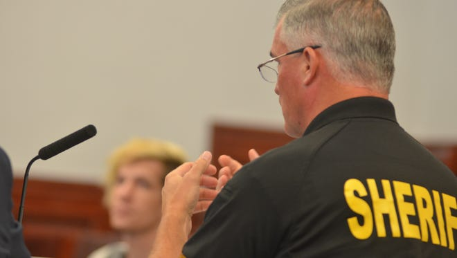 Cascade County Sheriff Bob Edwards explains to a judge that other states have been reinstating warrants issued to Montana, prompting officers to rearrest the alleged offenders. Cord H. Gibson, who was brought before two different judges twice on the same warrant, sits and listens to Edwards.