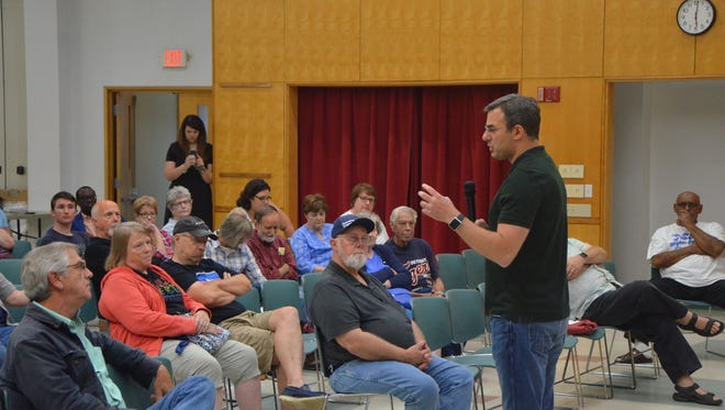 Rep. Justin Amash takes a question from the audience at his Battle Creek town hall Tuesday.