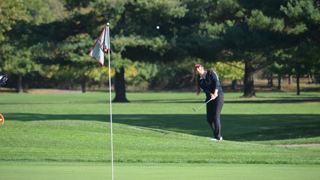 Shelby's Claire Korbas chips on to the green during Friday's first round of the Division II state girls golf tournament on Ohio State's Gray Course.
