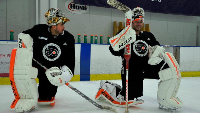 Goalies Michal Neuvirth, left, and Brian Elliott haven't had anything close to an equal split in the first five games.