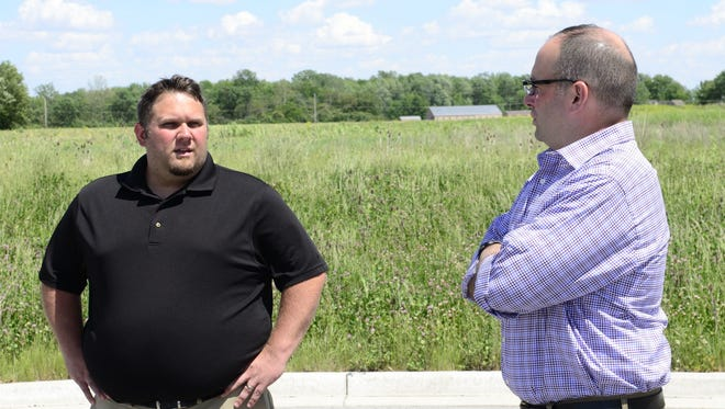 Steven Fought, mayor of Gibsonburg, left, and Marc Glotzbecker, village administrator, visited a proposed 50,000-square-foot medical marijuana processing plant at the village's Clearview Industrial Park in May.