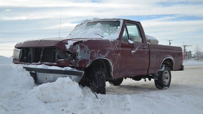 A damaged pickup pushed into a snowbank on Wednesday near McCullough's Wrecking tow company for a DUI crash demonstration.