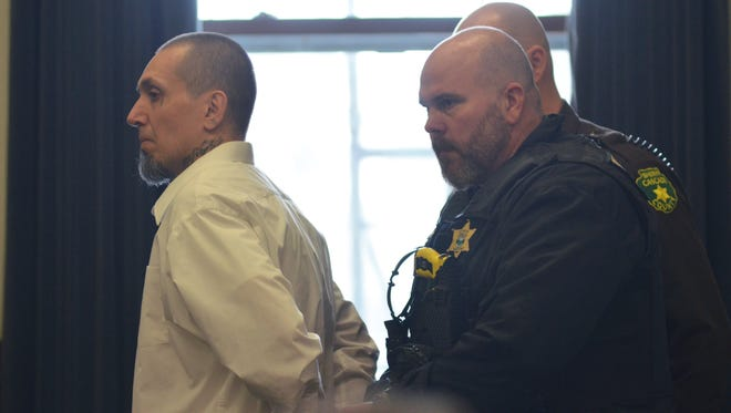 Bailiffs lead Stacy Trujillo out of the courthouse Wednesday after a jury found him guilty of attempted murder and tampering with evidence.