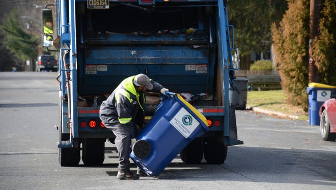 A Waste Industries crew collects recyclables in Georgetown.