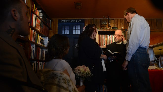 St. Clair couple Rosemary Gooch and Robert Hafeli are married at the Raven Cafe on Wednesday, Feb. 14, 2018, in Port Huron. The Rev. Pat Thompson was offering free ceremonies, including for same-sex couples, on Valentine's Day. The couple said they'd been together 12 years.