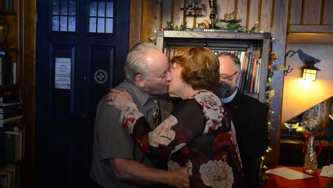 Rose Shafran and David Earl Sexton, of Port Huron, kiss as a married couple during a ceremony at the Raven Cafe on Wednesday, Feb. 14, 2018. The couple said they'd always intended to get married. The Rev. Pat Thompson was offering free ceremonies Wednesday for Valentine's Day.
