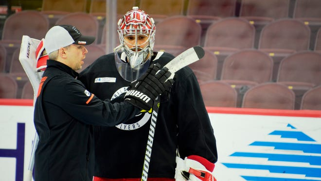 Goalie Petr Mrazek, right, arrived in Philadelphia on two hours sleep and went over a game plan with Flyers goalie coach Kim Dillabaugh.
